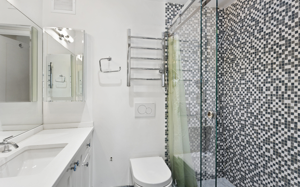 Beautiful bathroom photo of our bathroom tiling job done in Yarrawonga with black and white mosaic wall tiles https://www.norvictiling.com.au