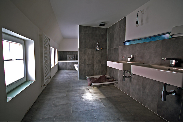 Large bathroom photo of our tiling job in Barham with large concrete finish floor and wall tiles