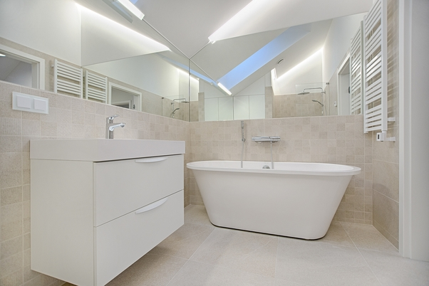 Our completed bathroom tiling job in Kerang with porcelain wall tiles and a large frameless bathroom mirror